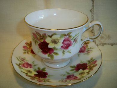 Vintage Queen Anne Roses Floral Footed China Teacup and Saucer